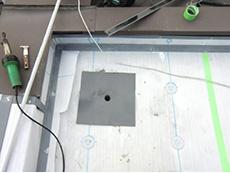 大山崎町の屋上防水リフォーム。塩ビシート専用の改修ドレンを取り付けます。